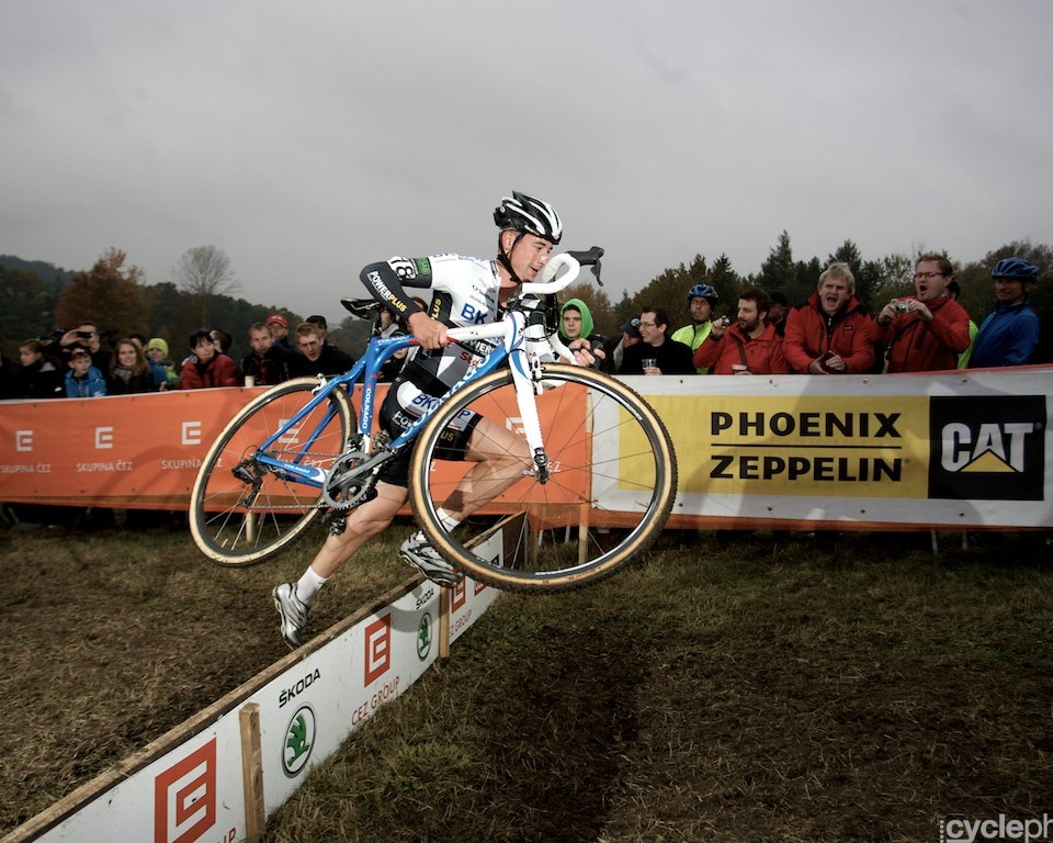 Radomir Simunek cleares the second obstacle during the first round of the cyclocross men's World Cup in Tabor, Czech Republic.