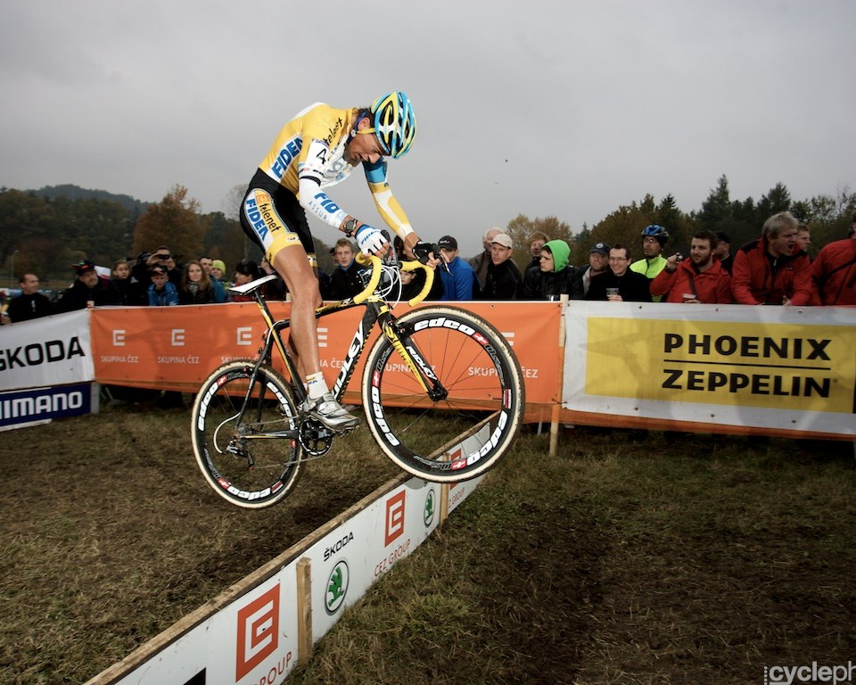Tom Meeusen bunny hops over an obstacle during the first round of the cyclocross men's World Cup in Tabor, Czech Republic.