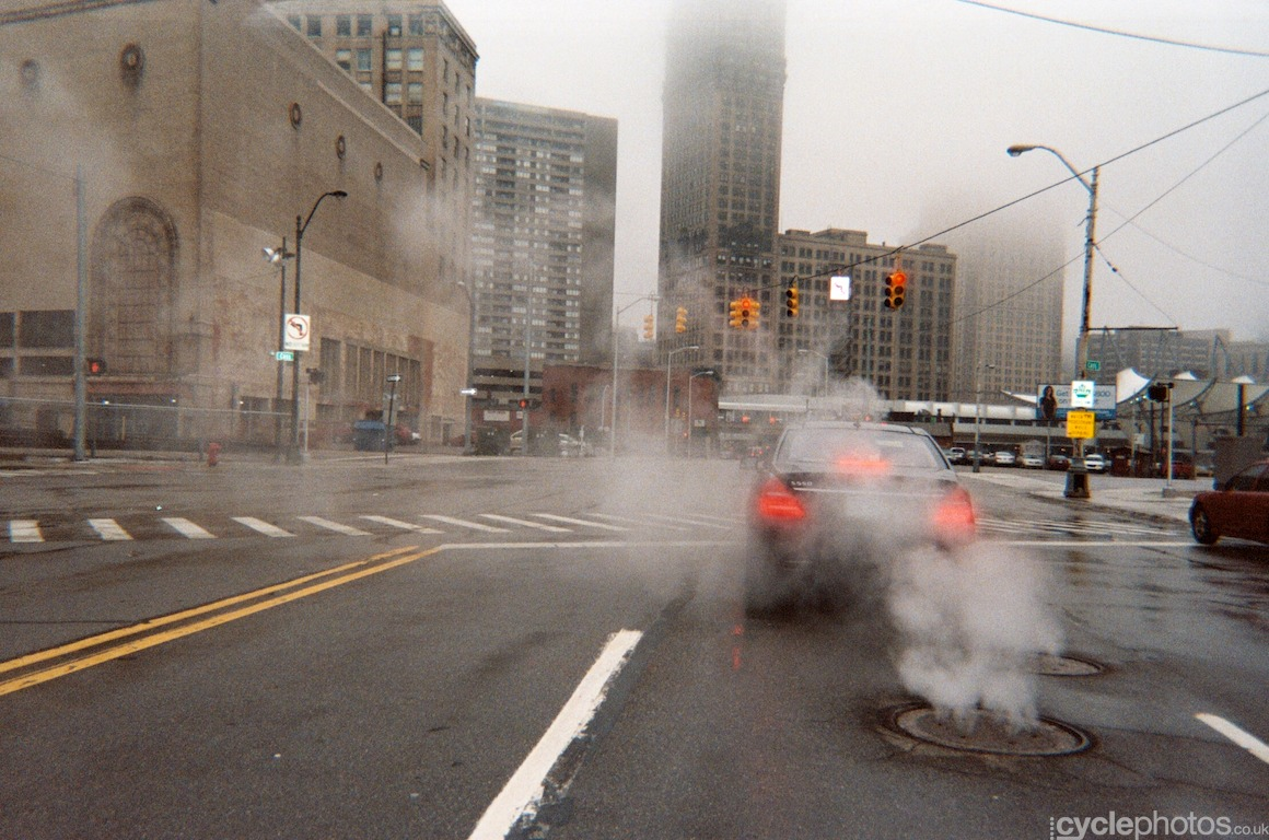 Steam envelops a car in downtown Detroit. Photo by Balint Hamvas / Cyclephotos