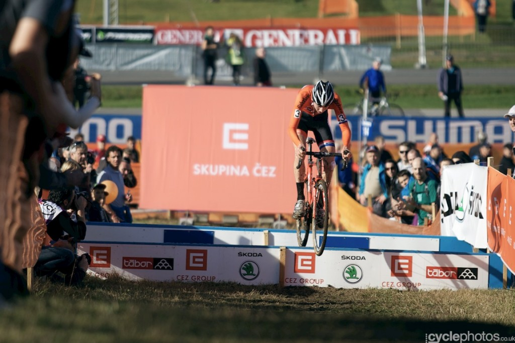 Mathieu van der Poel jumps across a plank in the fifth lap of the U23 riders ride in the third lap of the U23's cyclocross World Cup race in Tabor.
