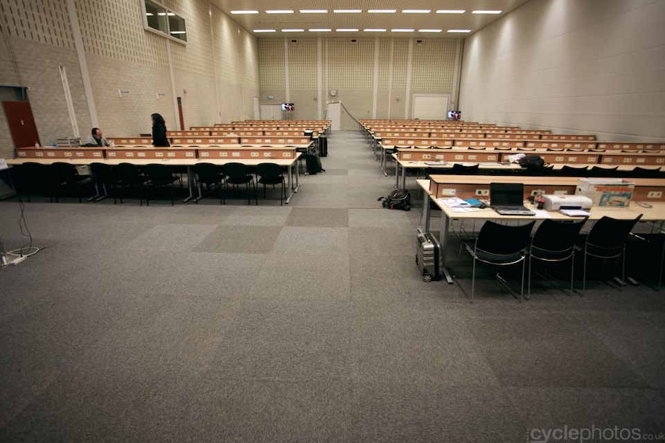 The press centre is empty. Not for long.