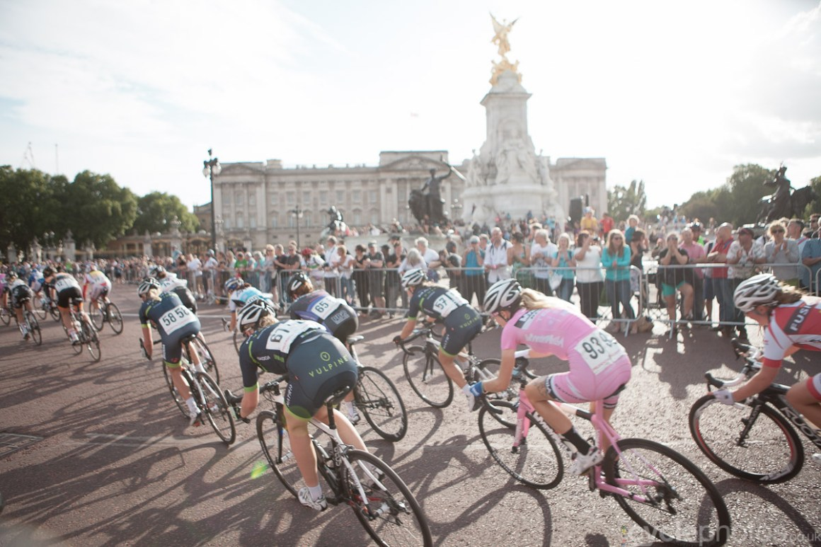 Riders ride past the Buckingham palace in the last lap of  the 2014 Prudential RideLondon Grand Prix.