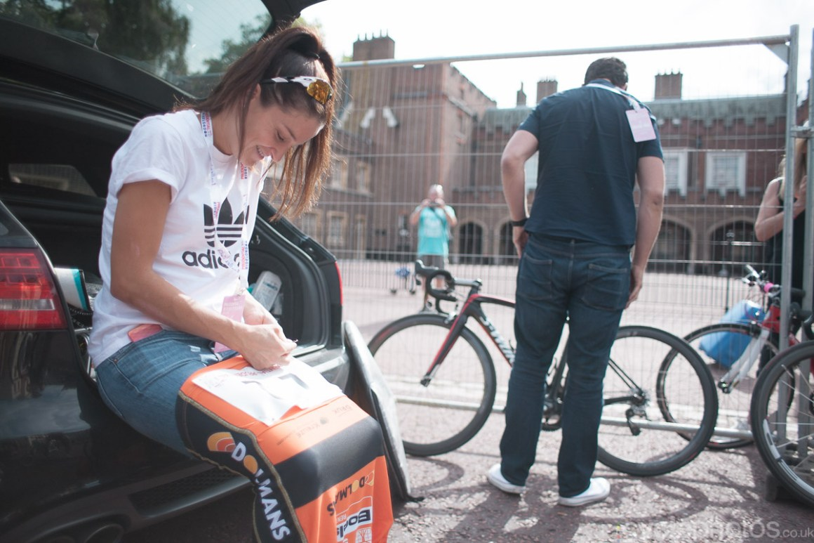Lizzie Armitstead pins on her race number on her skinsuit before the 2014 Prudential RideLondon Grand Prix.