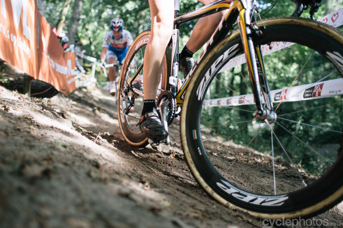 A rider corners during the women's cyclocross race at Neerpelt in 2013