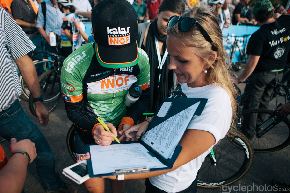 Elle Anderson signs the paperwork for her doping test after finishing of the first cyclocross World Cup race of the 2014/2015 season in Valkenburg.