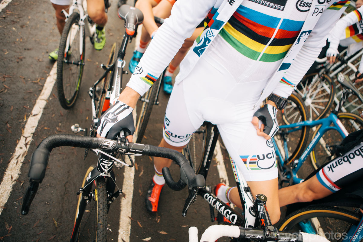 Wout Van Aert holds the bike of compatriot and rival Michael Vanthourenhout before the first cyclocross World Cup race of the 2014/2015 season in Valkenburg.