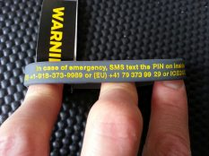 Wrist band contains clear instructions for the emergency services