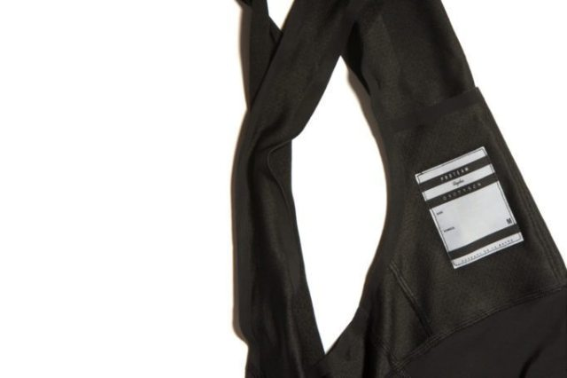 A radio pocket is provided on the rear of the bib