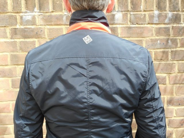 Fold up the collar for a little Hi-viz detail. The cut across the back allows for a relaxed riding position