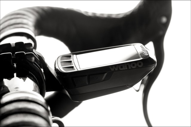 black and white image of bike handlebars with a GPS cycling computer.
