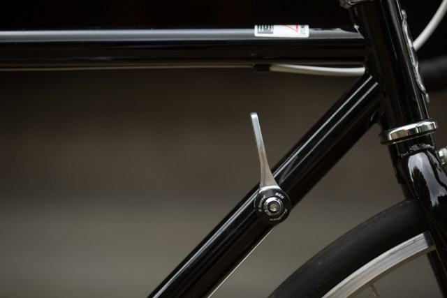 Side view of the front of a bicycle frame with a downtube shift lever