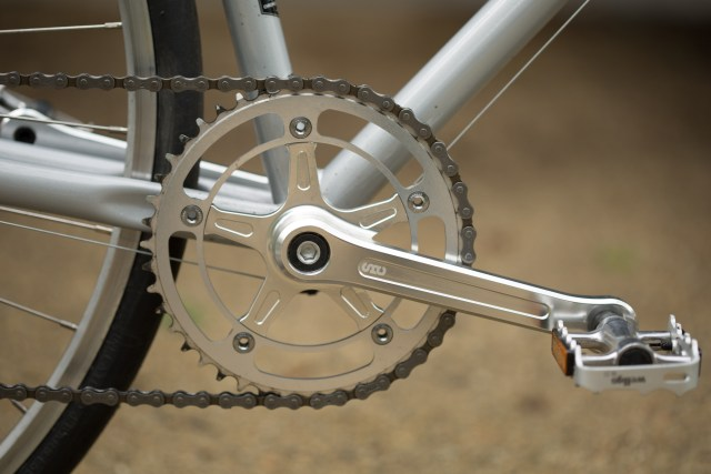 side shot of the State Bicycles 4130 CNC machined crank with an out of focus background.
