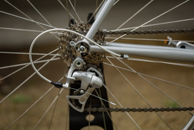 rear cassette and derailleur on a road bike with an out of focus background