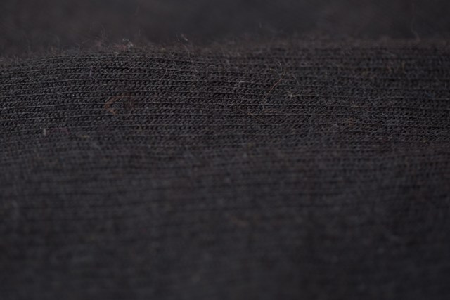 close up on black alpaca wool cycling socks.