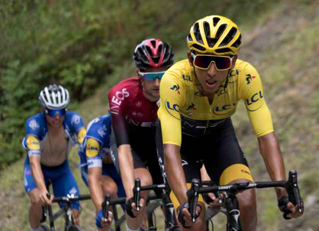 Egan Bernal wearing the yellow leaders jersey and Oakley Sutro Glasses in the 2019 Tour de France