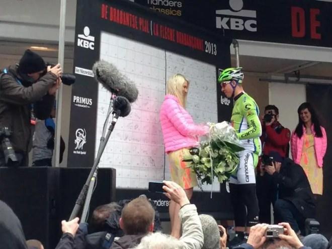 Peter Sagan gives flowers to Maya Leye