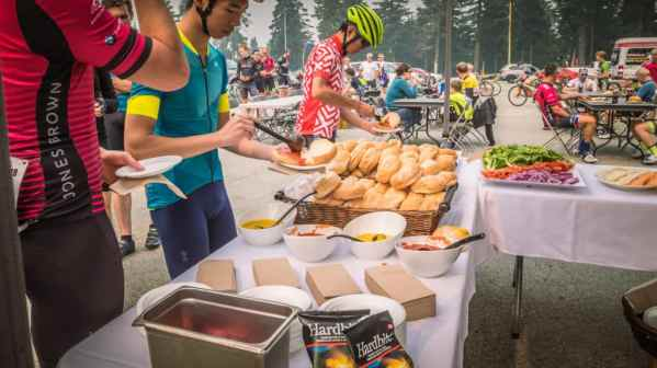 Cyclists at the top enjoying BBQ food