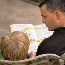 Father and Child Reading Cycling Books