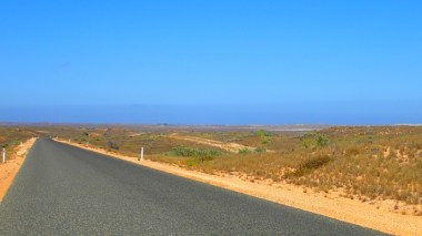 Coral Bay is a faint smudge centre on the horizon