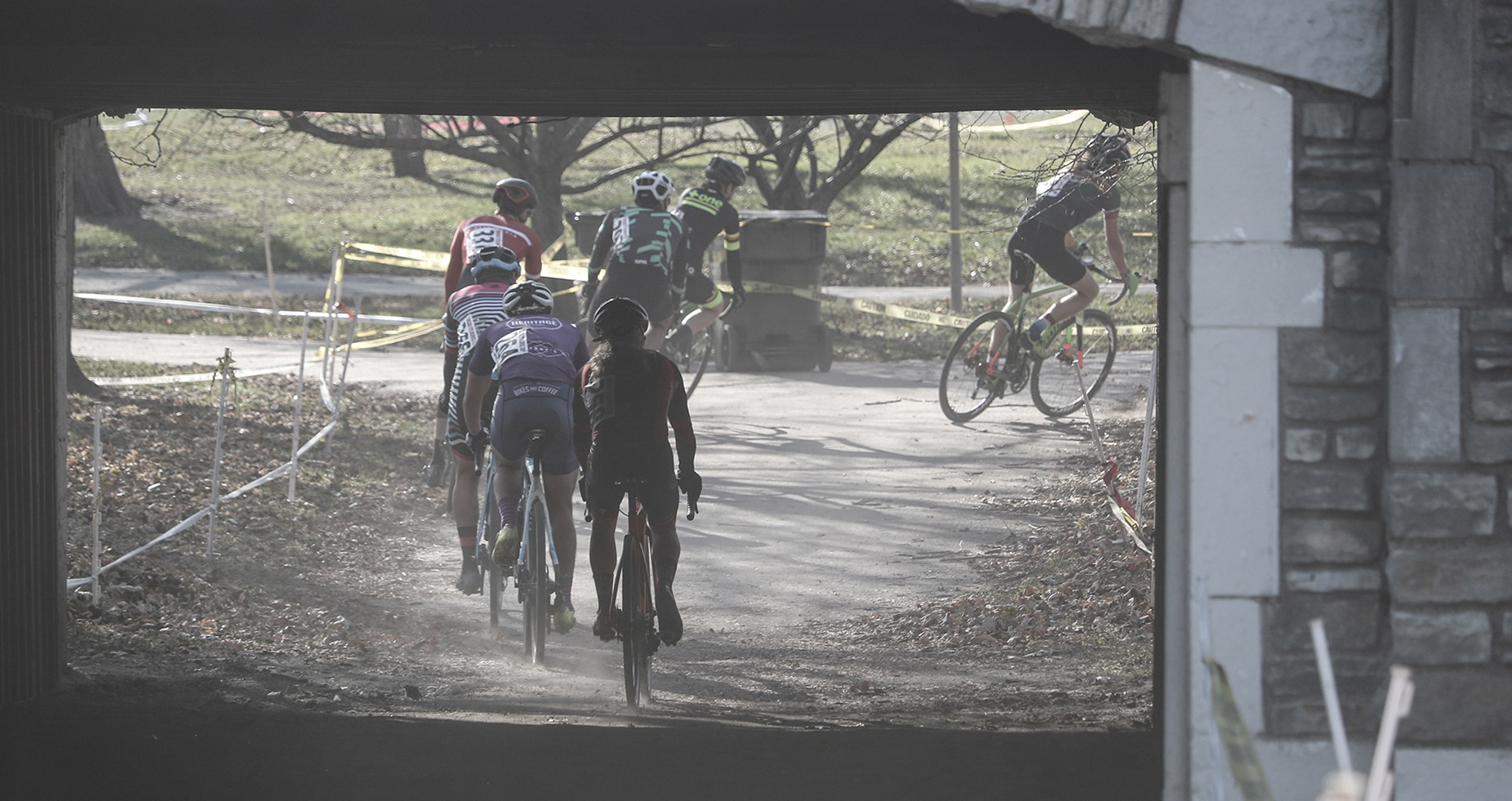 Racers riding under the bridge