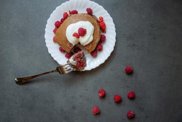 Chocolate pancakes with raspberries