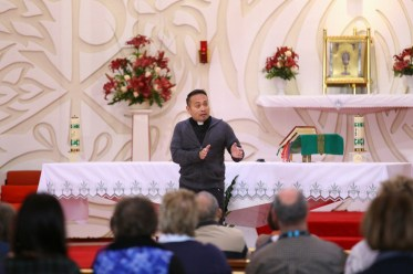 Fr. Leo presenting a speech at the church for peers