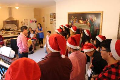 Bentley Youth Christmas Caroling friends singing with each other