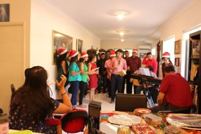 friends singing together on Christmas