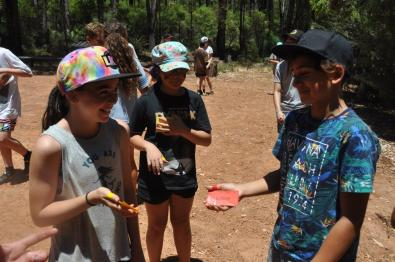 Young kids at camp having fun and laughing with each other