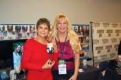 Nancy Jones with Cyndie Wade holding her custom wine glass of George Jones.