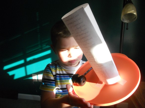 Playing with the lid-hat in the sunshine, not the middle of the night.