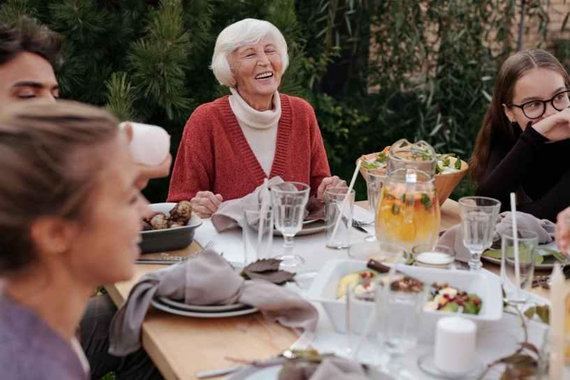 happy family enjoying dinner in garden