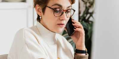 serious director talking on cellphone in cozy office