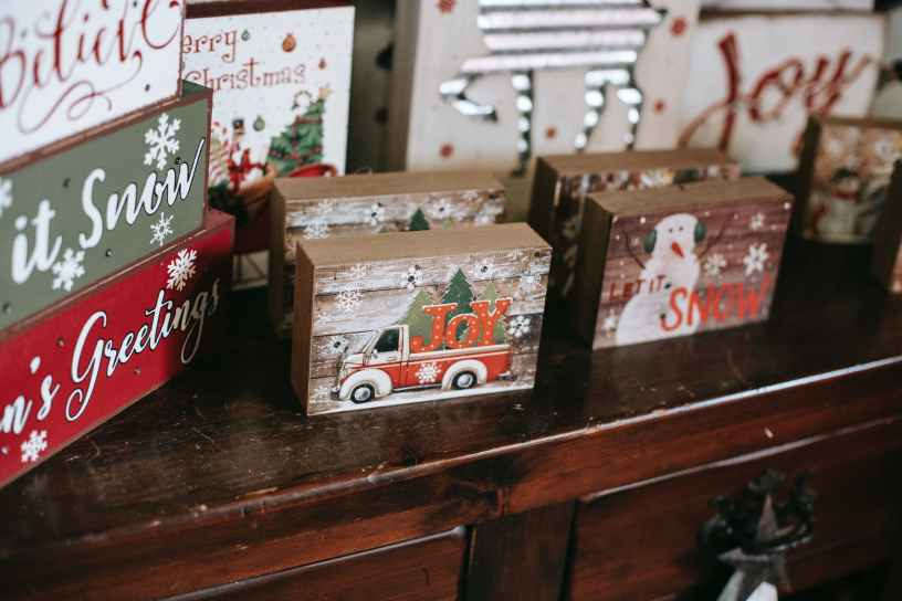 assorted wooden boxes with christmas decor on commode