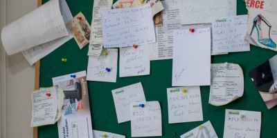 information board on wall with papers in room