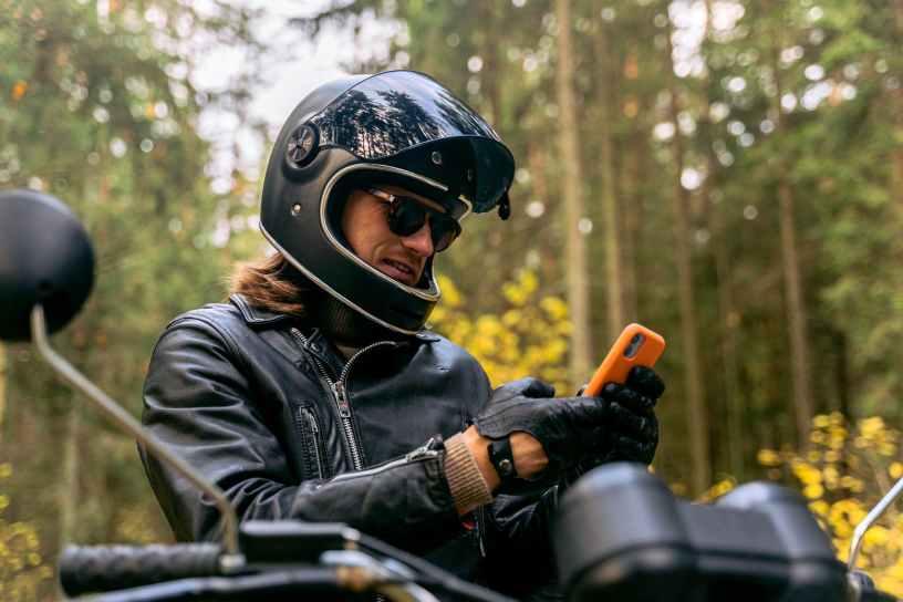 man in black jacket wearing helmet and helmet
