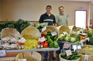 Father and son market vendors, Michael Withrow and Brian Withrow of Withrow's Farm, say the new wheelchair ramp makes it easier to get produce in and out of the Sunday community market.