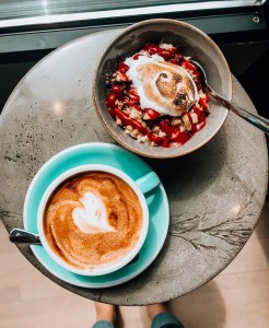 latte with milk heart, gourmet oatmeal. food flatlay. warm, cozy. fall inspired.