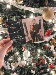 christmas card next to a lit up christmas tree.