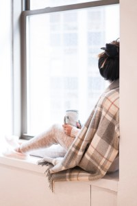 girl sitting on window sill staring out window with coffee cup. 5 things to do when you want to give up