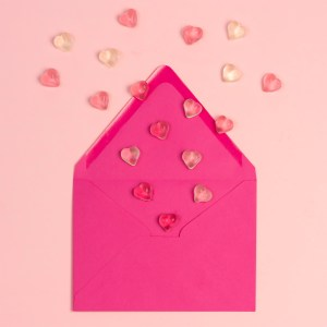 pink envelope with valentine's gummy candies coming out of it!