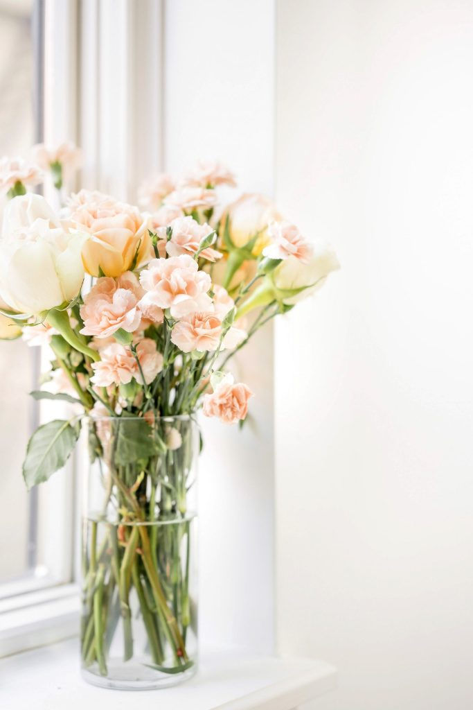 vase of flowers sitting by window sill. monthly favourites round-up: april edition