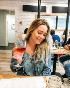 girl drinking wine at pure kitchen. rosé. wine babes of ottawa.