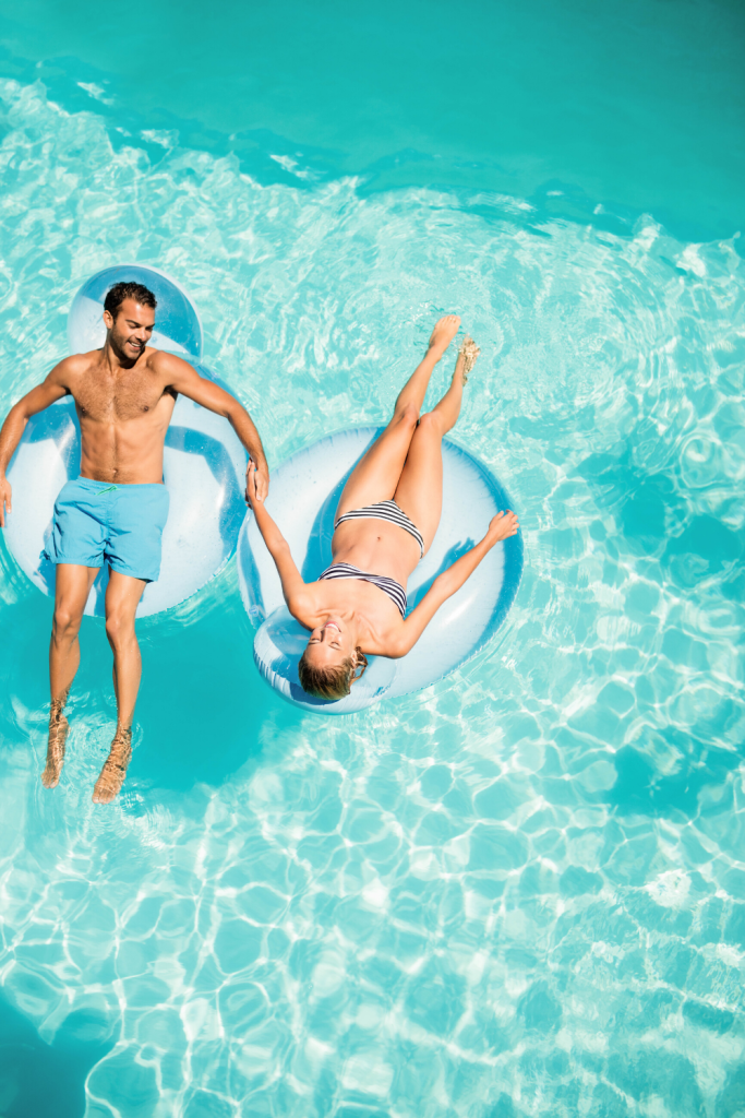 couple sitting on pool floaties, 17 Summer Date Ideas You Need to Try