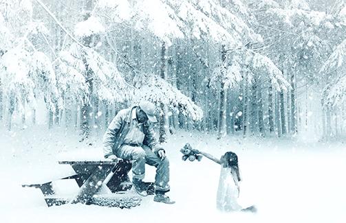 Little girl giving her teddy bear to a sad man