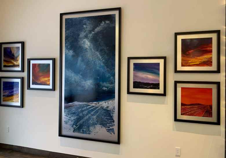 Gallery wall detail of Celestial Rhapsody and my sunset paintings!