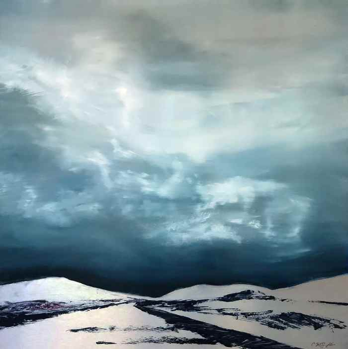 Silver relief mountains and road brings the viewer to the horizon of a dramatic, stormy blue sky. By artist Cynthia McLoughlin © 2018.