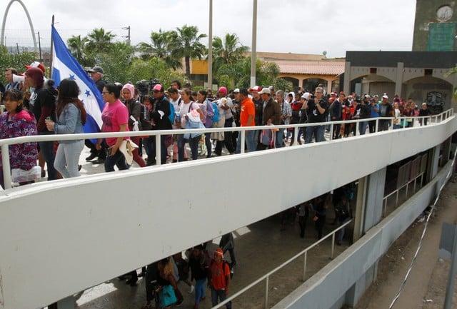 Migrants from caravan in limbo as US says border crossing full