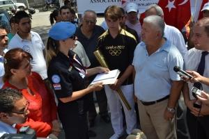 Kerem Hassan (right), Grand Master Eyüp Zafer Gökbilen (centre right) hand a letter to a UN representative whilst HaticeSalih Kerimgil (le -