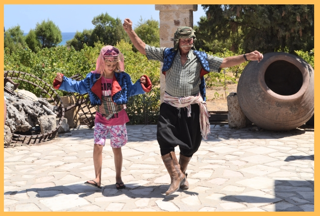 Amber (left) Cemel (right) dancing to traditional music